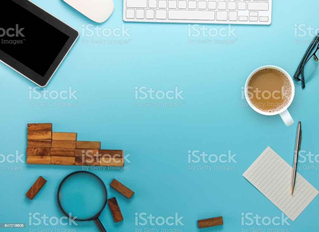 top view of empty  space with office tool on soft blue background stock photo