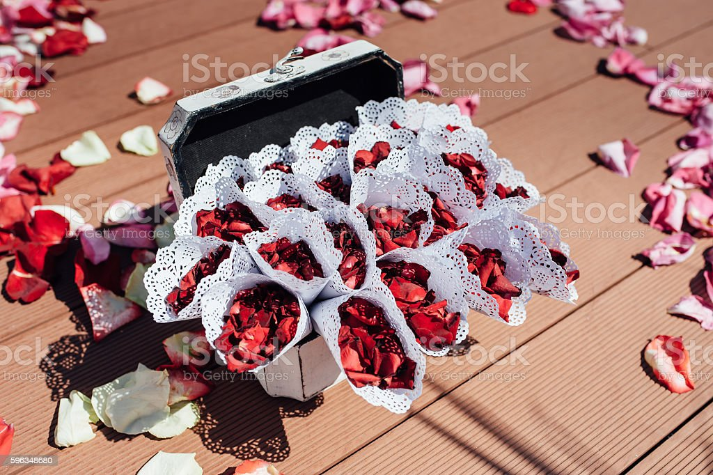 top view of envelopes with rose petals for event royalty-free stock photo