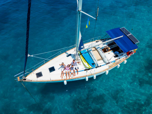 Top view of Family with adorable kids resting on yacht stock photo