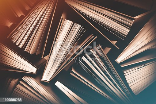 Top View of Fanned Out Books Pattern in Dark Background