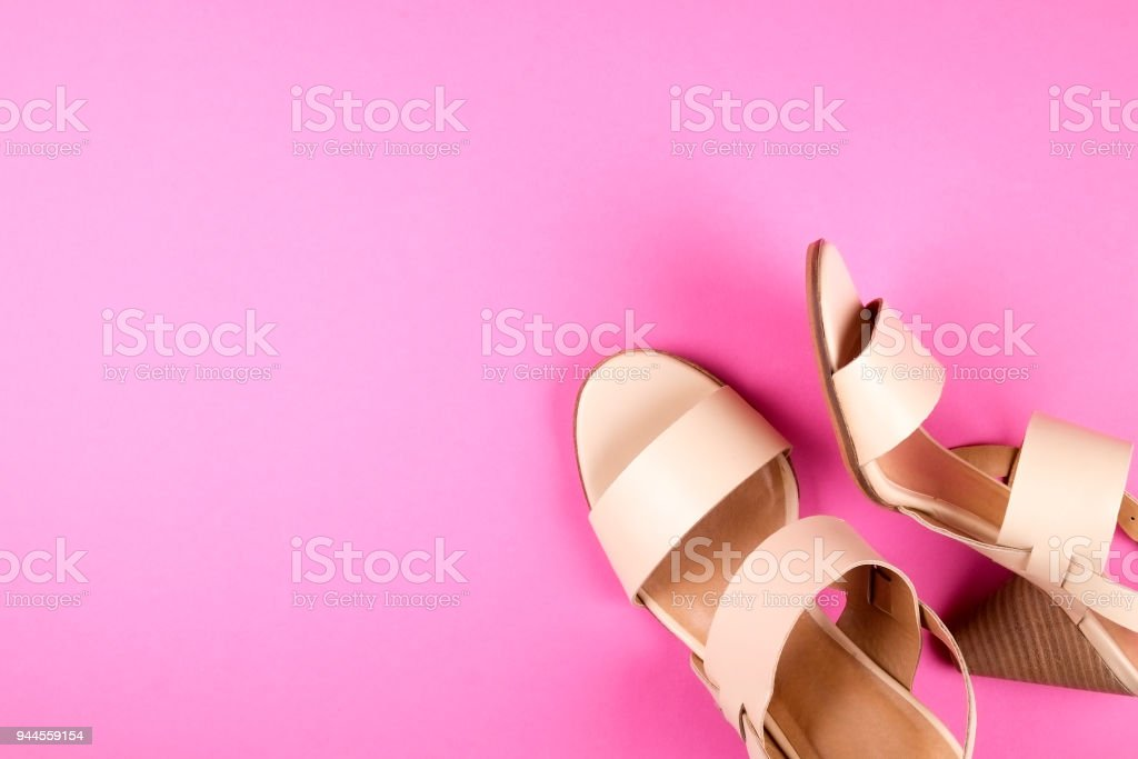 Top view of fashionable feminine medium heeled women's leather shoes of pastel colors on heels / wedge for spring-summer season. stock photo
