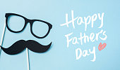 event design concept - top view of fathers day layout with silhouette of eye glasses and beard, copy space for mock up