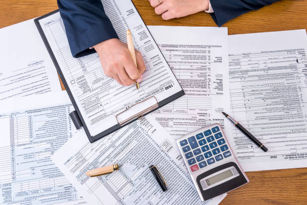 2,795 Income Tax Preparation Stock Photos, Pictures & Royalty-Free Images - iStock