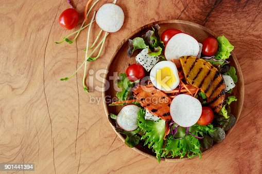 879977192 istock photo Top view of fesh salad On wooden background. 901441394