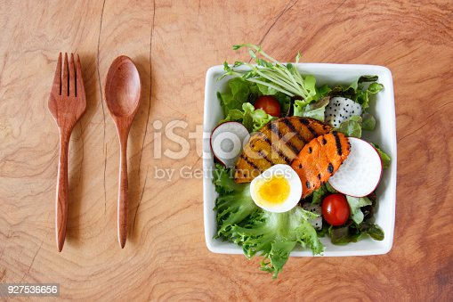 879977192 istock photo Top view of fesh salad on wooden background. 927536656