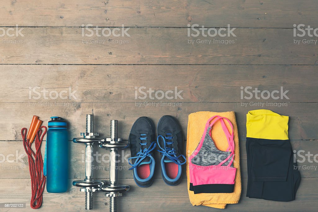 top view of fitness, gym equipment on wooden floor - foto stock