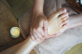 Top view of foot massage in spa salon.