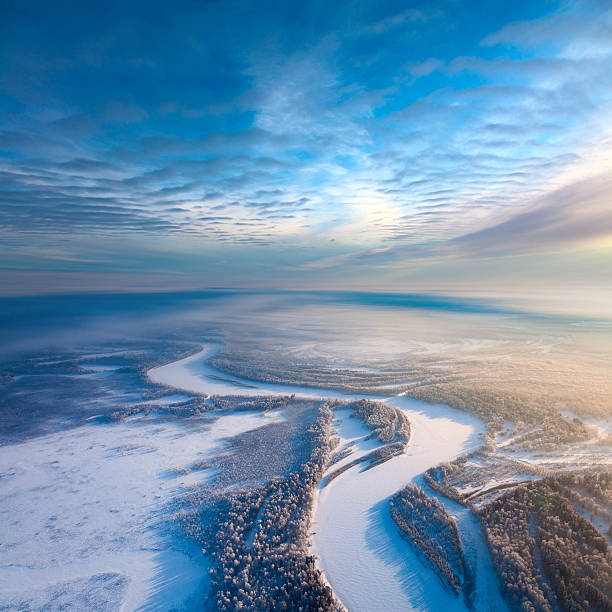 top view of forest river in winter - siberië stockfoto's en -beelden
