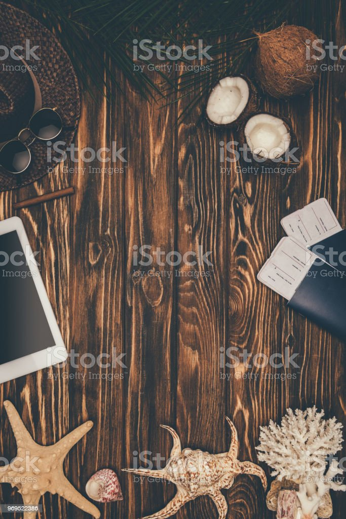 top view of frame made of digital tablet with flight tickets and travel attributes on wooden surface stock photo