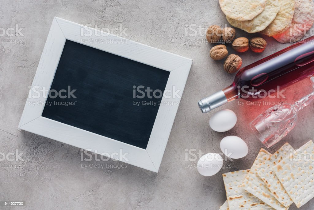 top view of frame, wine and matza, jewish Passover holiday concept stock photo