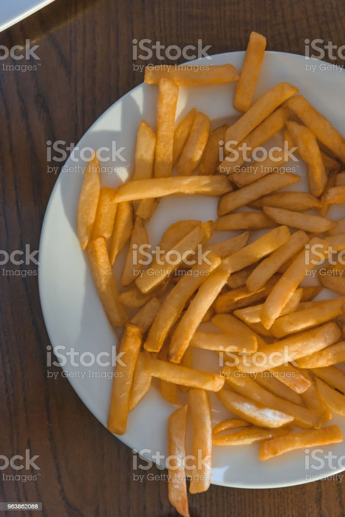 top view of french fries over white plate - Royalty-free Bar - Drink Establishment Stock Photo