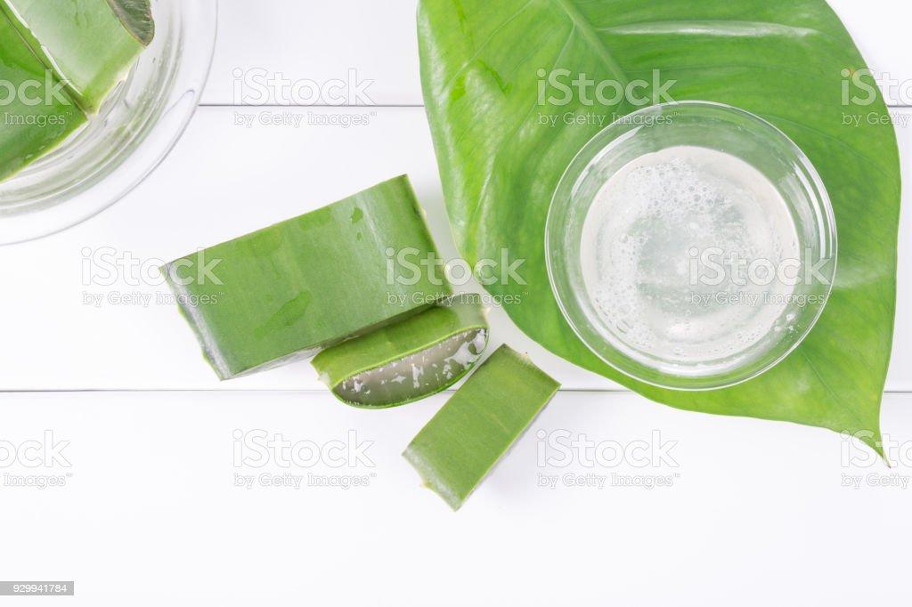 Top view of fresh aloe vera leaves with aloe vera juice stock photo