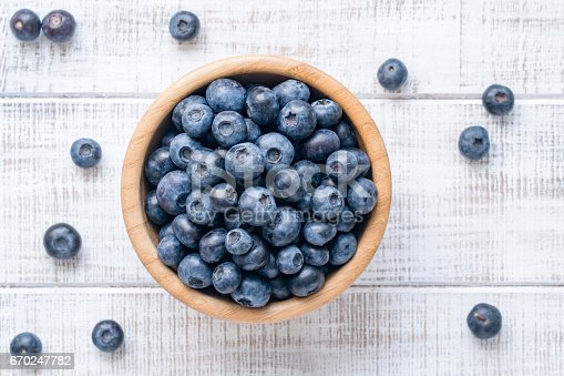istock Top view of fresh blueberries in bowl 670247782