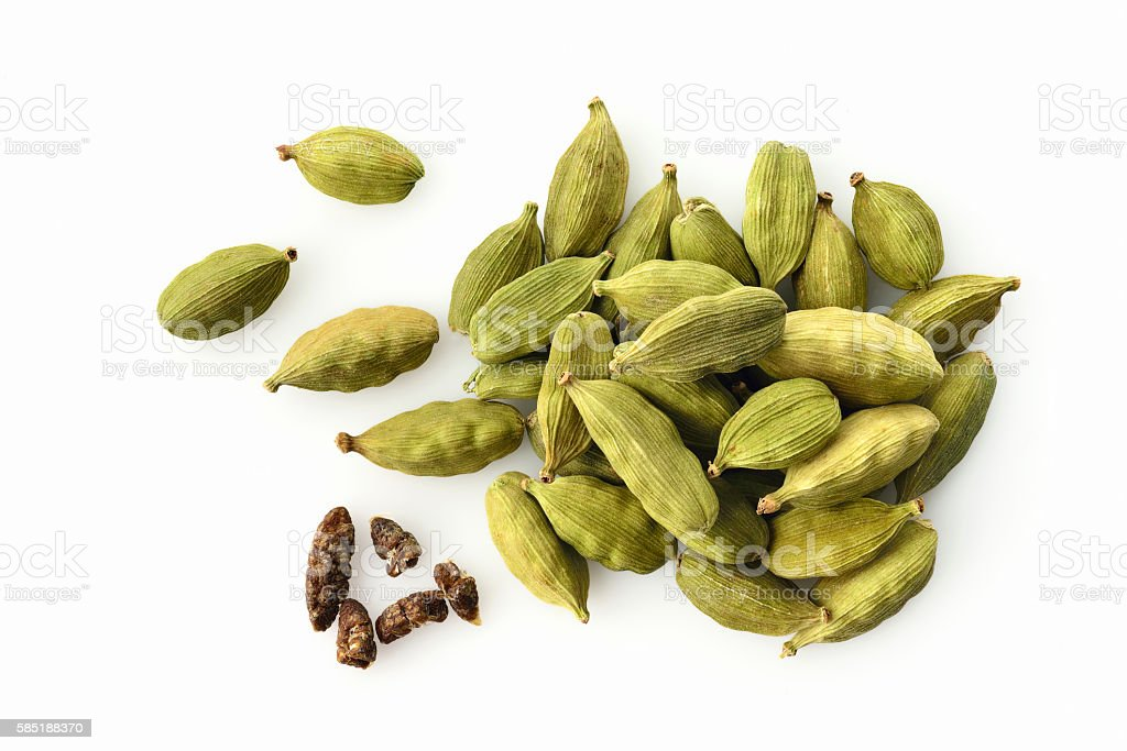Top View of Fresh Green Cardamom On White Background stock photo