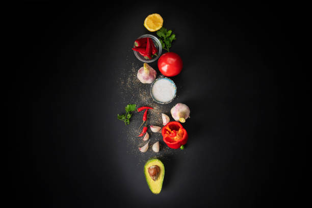 top view of fresh guacamole ingredients, natural organic vegetables on the table, home cookings stock photo