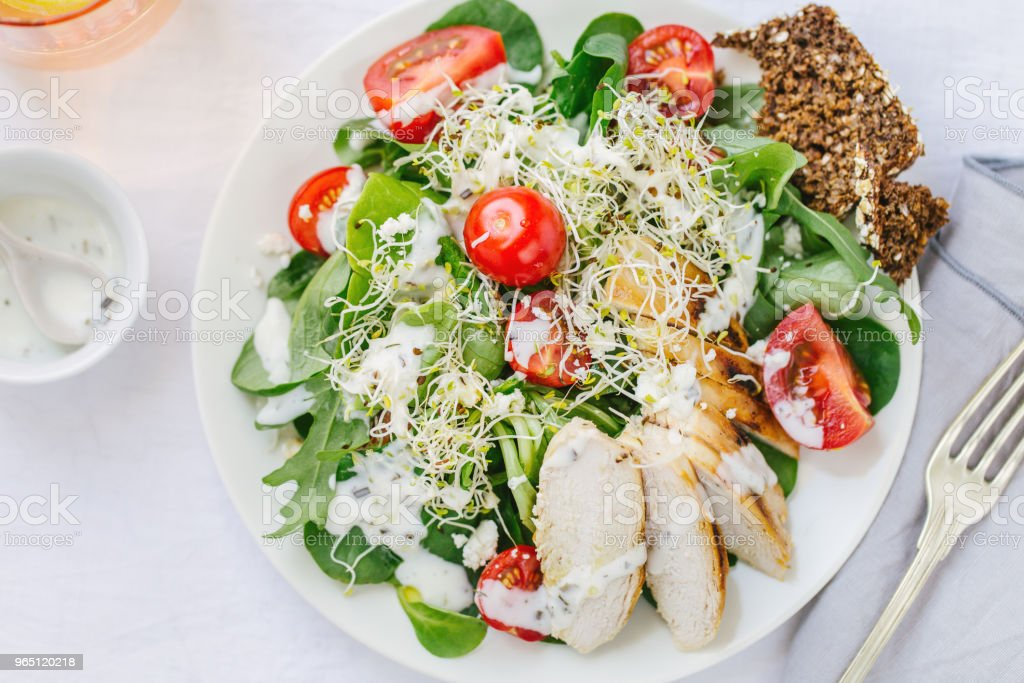 Top view of fresh summer salad on plate on table royalty-free stock photo