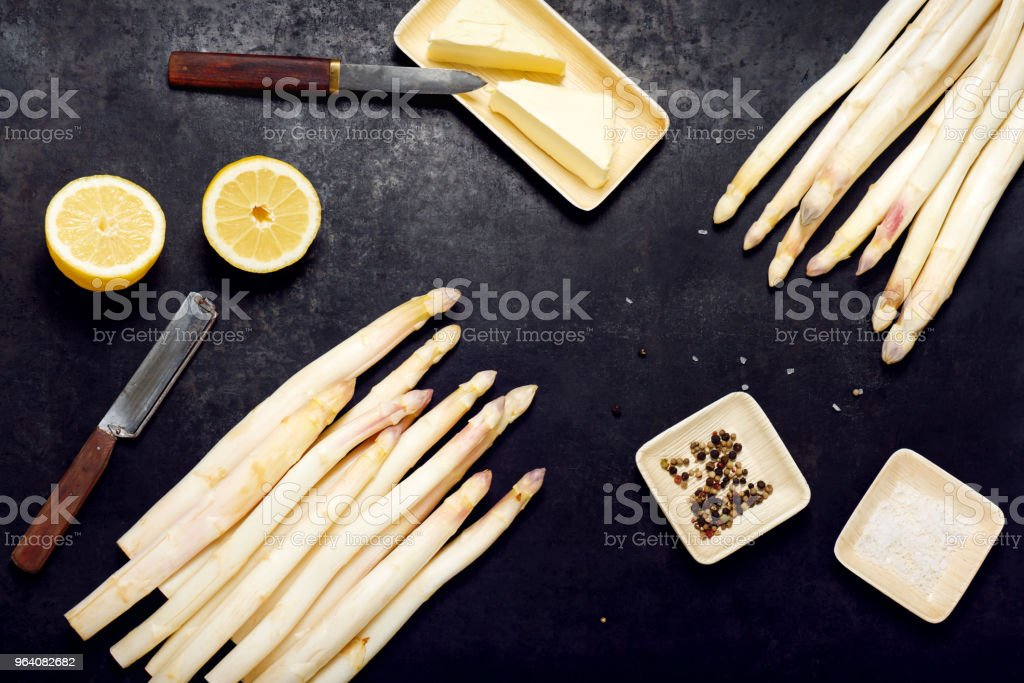 Top view of fresh white asparagus with spices, salt, lemon and butter ready to cook. - Royalty-free Asparagus Stock Photo