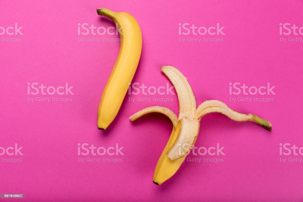 Top view of fresh yellow bananas isolated on pink, ripe bananas stock photo