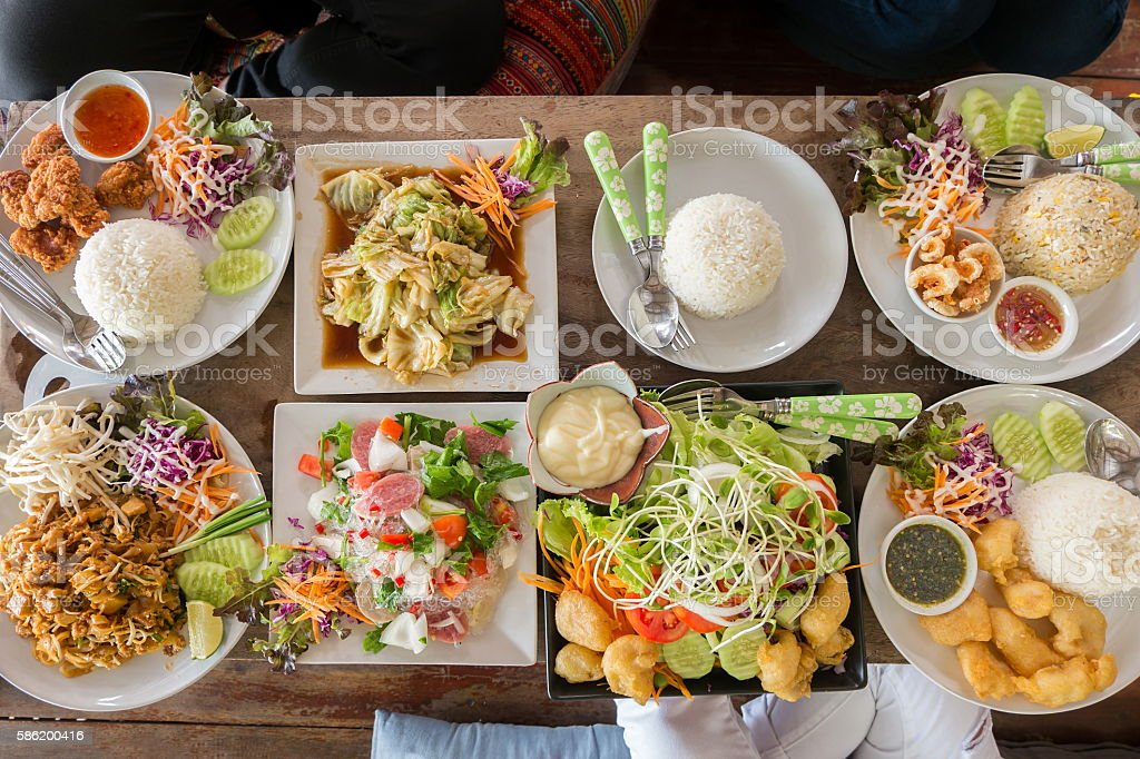 Top view of friends having lunch with various food stock photo
