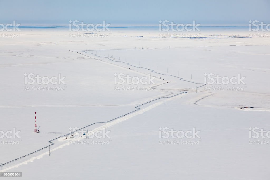 Top view of gas pipeline in tundra stock photo