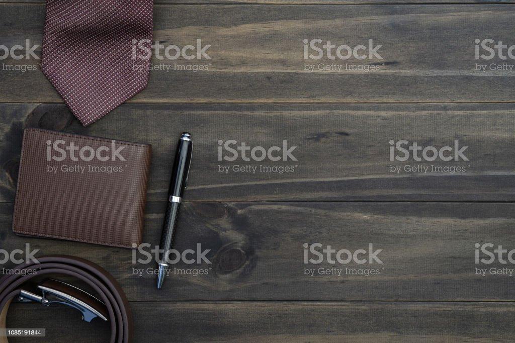 Top view of gentlemen accessories on wood background. Wallet, belt,...