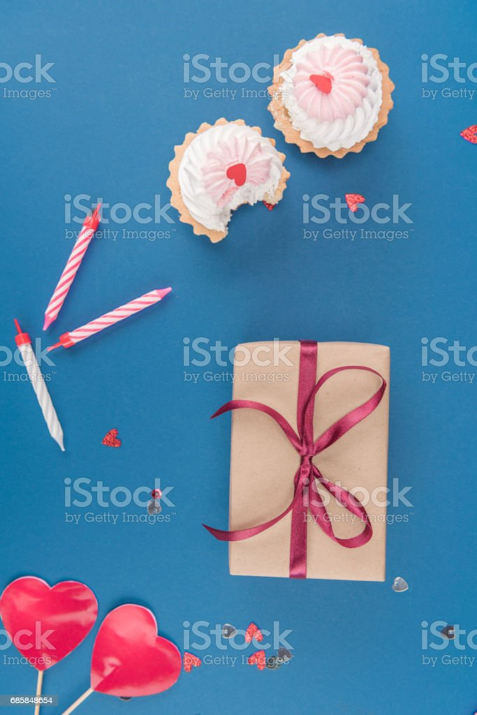 Top view of gift box cakes and candles isolated on blue birthday top view of gift box cakes and candles isolated on blue birthday party concept negle Choice Image