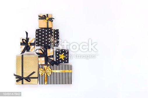 istock Top view of gift boxes in various black, white and golden designs. Flat lay. A concept of Christmas, New Year, birthday celebration event. 1049147942