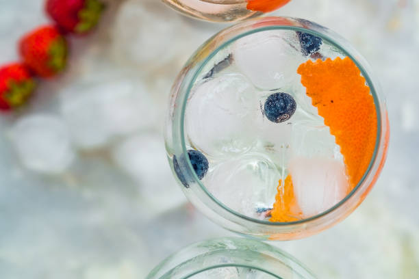Top view of gin tonic cocktail with blueberries and orange. stock photo