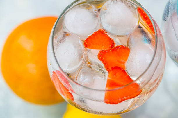 Top view of gin tonic cocktail with strawberries. stock photo