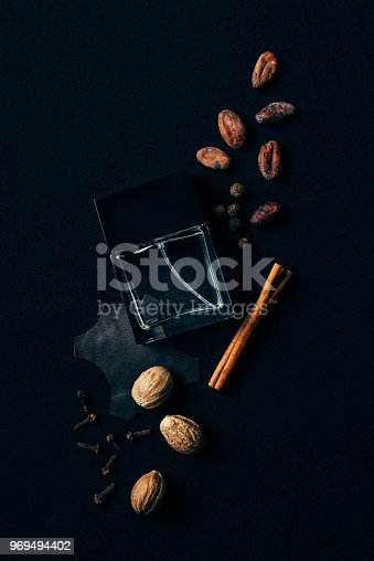 istock top view of glass bottle of perfume surrounded with aromatic spices on black 969494402