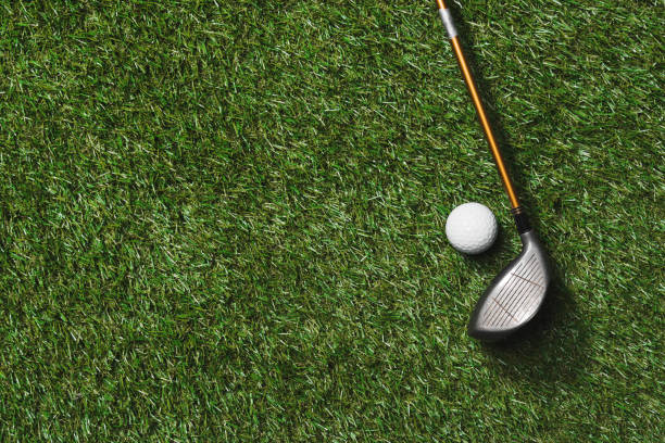 top view of golf club and ball on grass field - golf clubs stock photos and pictures