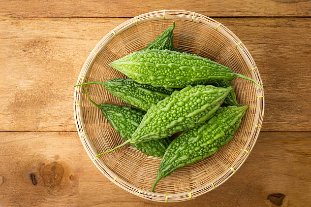 Top view of green bitter gourds in the basket. stock photo