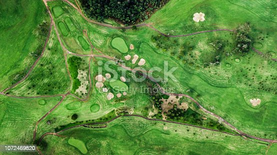 Drone top view of green grass golf course field