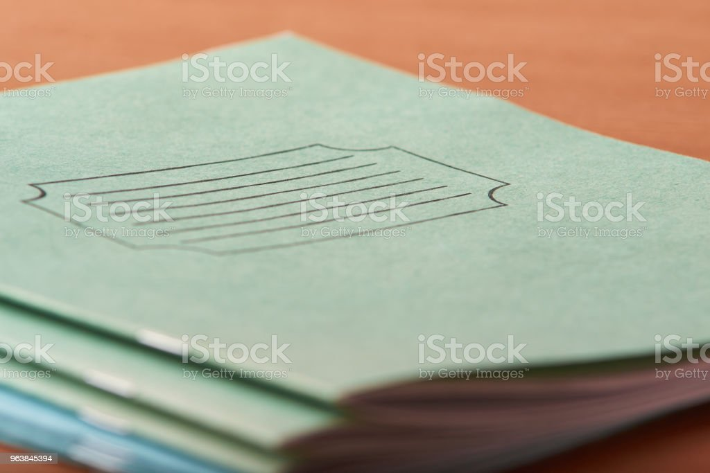 Top view of green notebook withon wooden table - Royalty-free Above Stock Photo