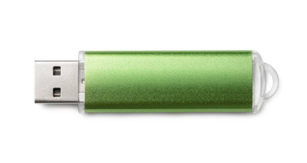 Top view of green USB flash drive Top view of green USB flash drive isolated on white usb stick stock pictures, royalty-free photos & images