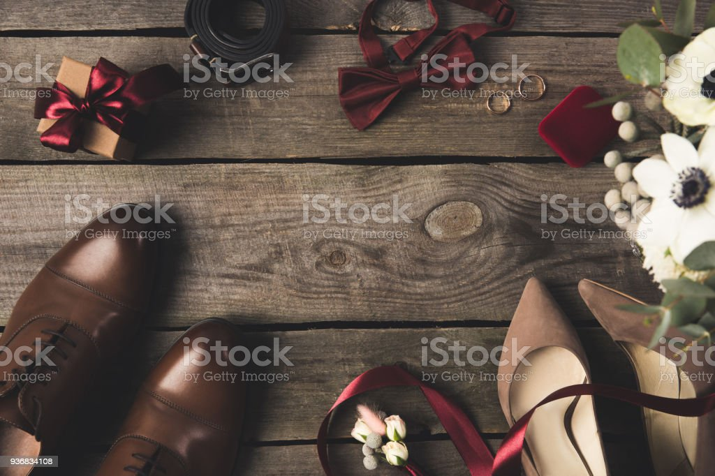 Top view of grooms accessories and wedding rings on wooden tabletop top view of grooms accessories and wedding rings on wooden tabletop royalty free stock photo junglespirit Image collections