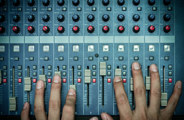 Top view of Hands adjusting audio mixer, music instrument concept Top view of Hands adjusting audio mixer, music instrument concept sound mixer stock pictures, royalty-free photos & images