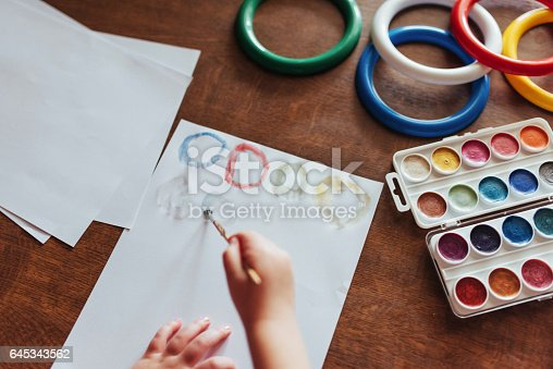 636761588istockphoto Top view of hands and brush paint watercolor  gouache 645343562
