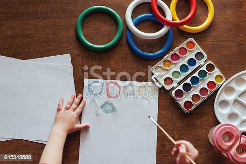 636761588istockphoto Top view of hands and brush paint watercolor  gouache 645343588
