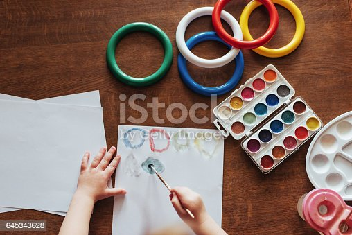 636761588istockphoto Top view of hands and brush paint watercolor  gouache 645343628
