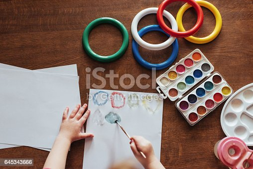 636761588istockphoto Top view of hands and brush paint watercolor  gouache 645343666