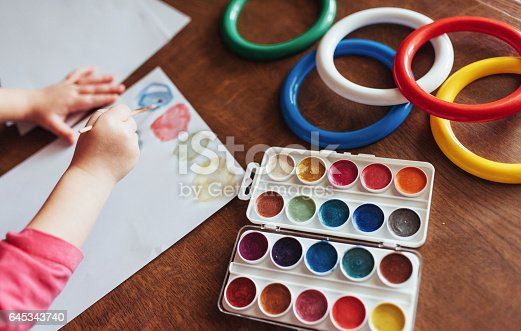 636761588istockphoto Top view of hands and brush paint watercolor  gouache 645343740