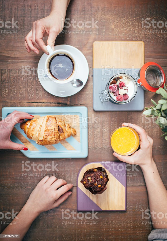 Top view of hands taking food and drink