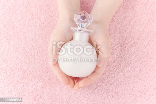 1151624350istockphoto top view of hands with a bottle of liquid soap or bath foam on pastel pink background 1199608938