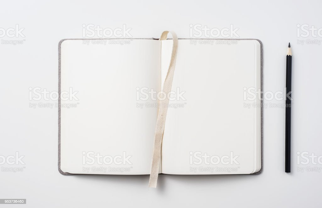 Top view of hardcover gray linen notebook and ballpoint pen stock photo