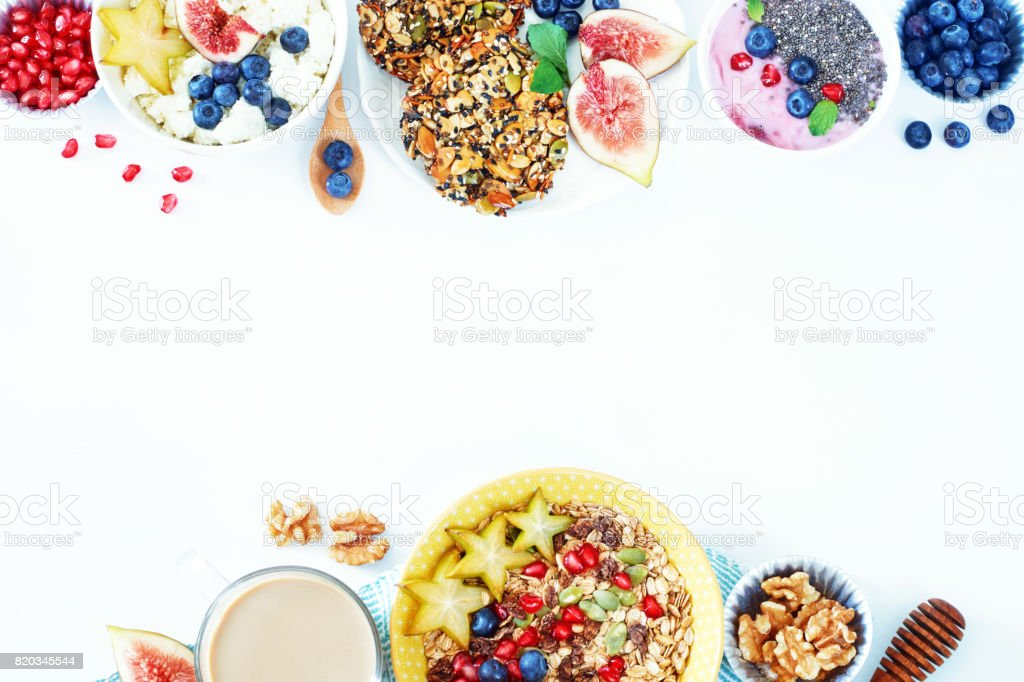Top view of healthy breakfast food frame over white background with a place for text. stock photo