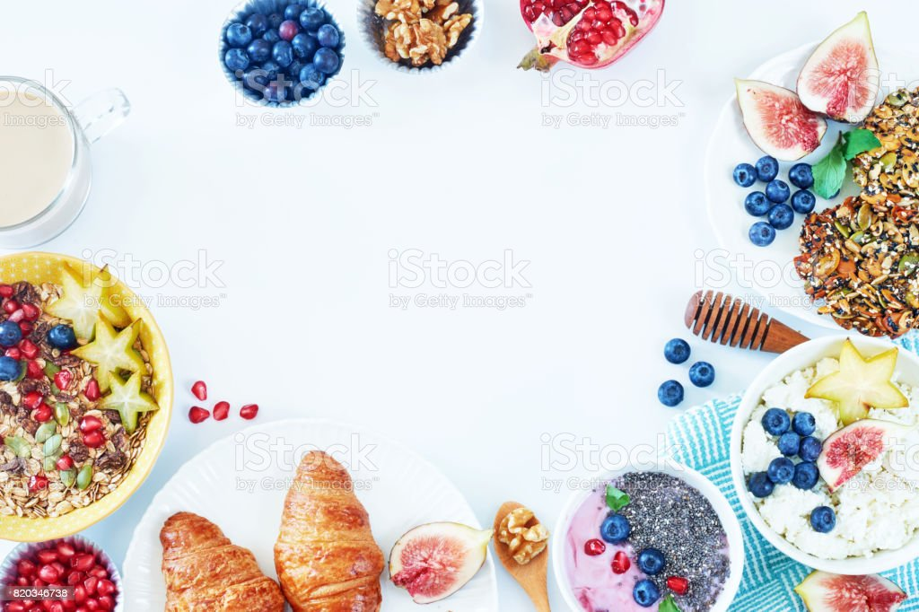 Top view of healthy breakfast food frame over white board with a copy space. stock photo