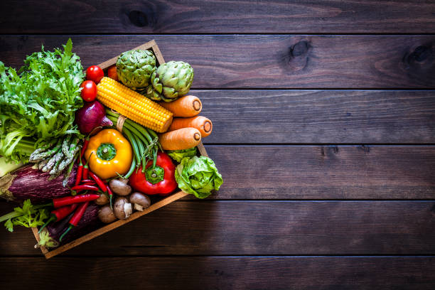 top view of healthy vegetables in a wooden crate - vegetable stock pictures, royalty-free photos & images