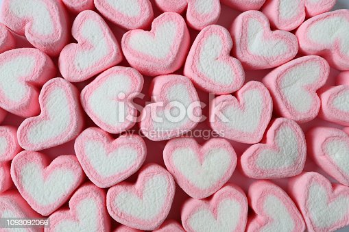 157527860 istock photo Top View of Heap of Pastel Pink and White Heart Shaped Marshmallow Candies for Background, Banner, Pattern 1093092066