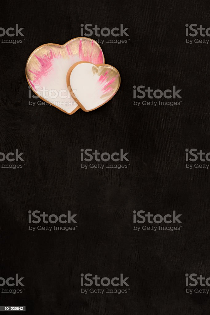 top view of heart shaped cookies on dark surface stock photo